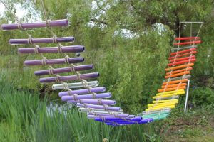 Dramatic Rainbow Glass Rope Bridge by Adam Aaronson